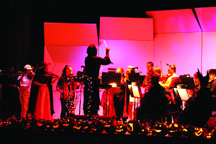Orchestra teacher Steve Olson conducts the Halloween-inspired concert at CMR in October.